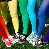 Цветные кеды и колготки на девичьих ножках
